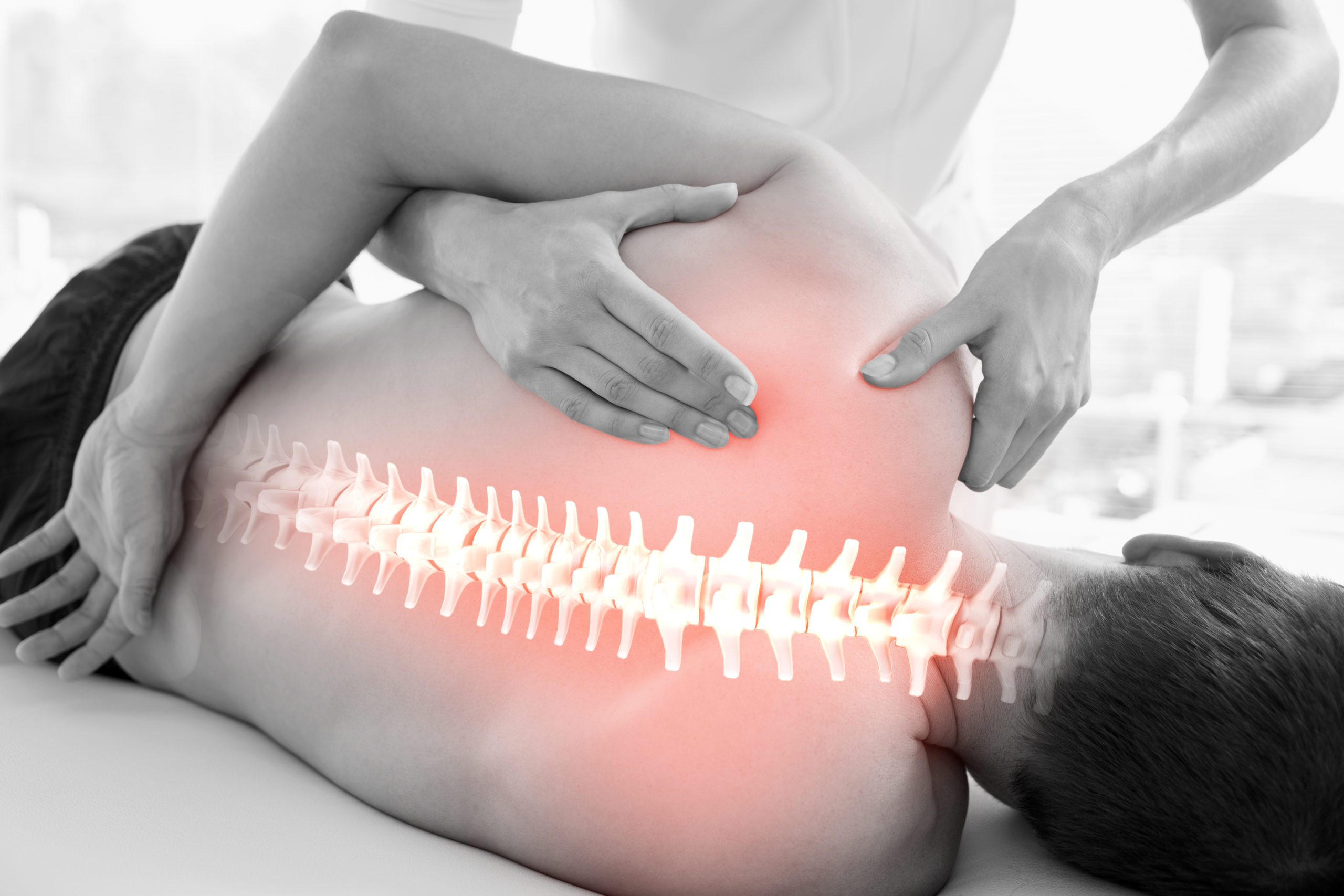 Digital composite of Highlighted spine of man at physiotherapy